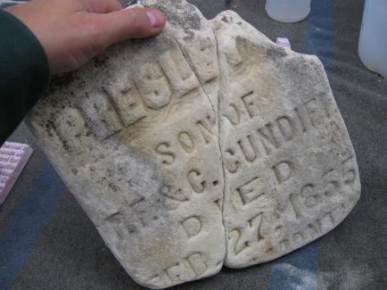 Possible Solution: This is a example of a historic stone conservation repair approach. No materials are placed on the front of the stone - repair is made from the back without pins.